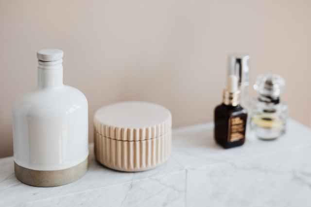 marble shelf for cosmetics storage in modern bathroom