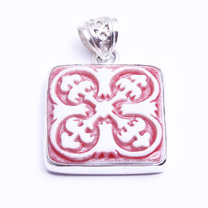 Petali, a hand carved porcelain pendant set in sterling silver; available in red, blue, light blue and grey.
