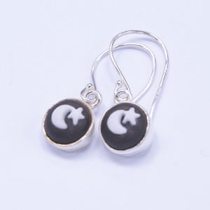 Moon is a small porcelain and sterling silver earring design
