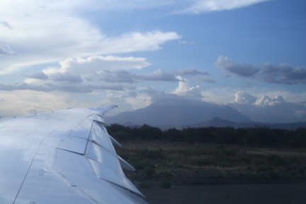 Mt. Kilimanjaro from the ground, the peak is hiding behind the clouds.