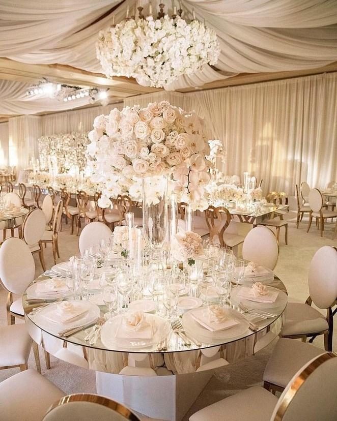tall white floral centerpiece in winter wedding