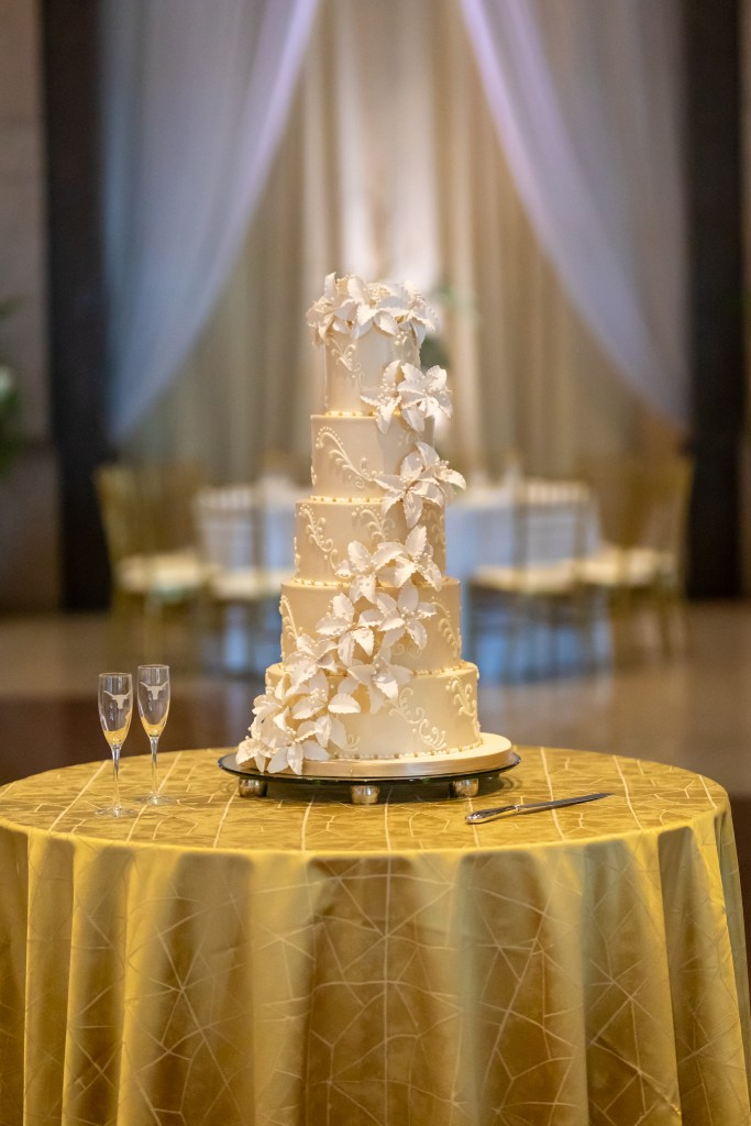 """An ivory cake topped with gorgeous blooms that sing """"romance!"""""""