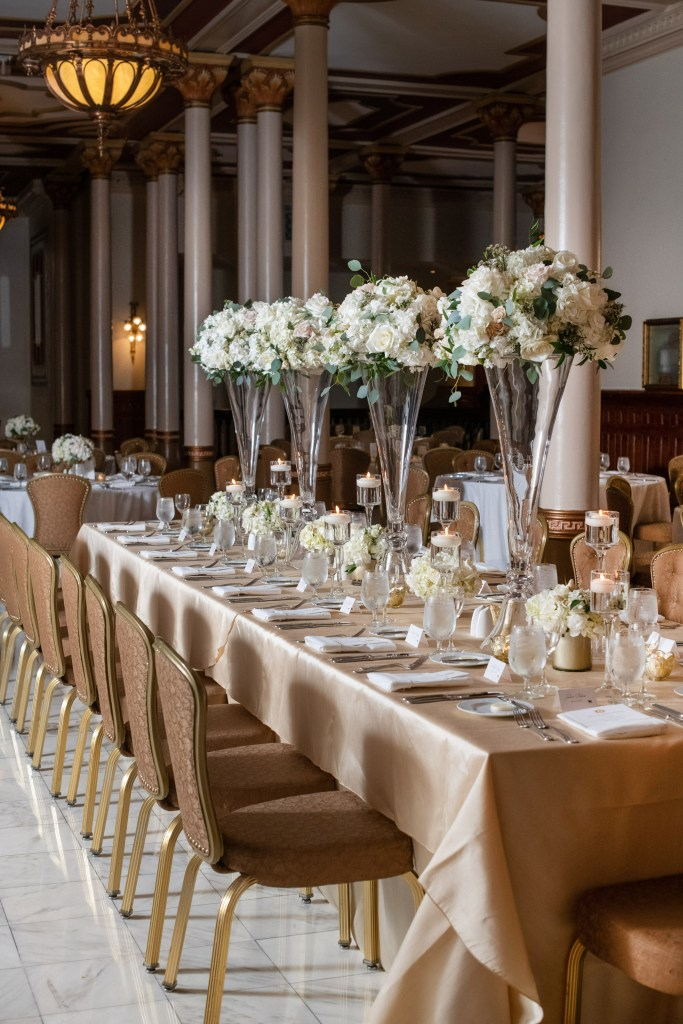 These lofty and bright arrangements at this timeless spring wedding truly complete this table-scape, perfect to seat such a classy bridal party!