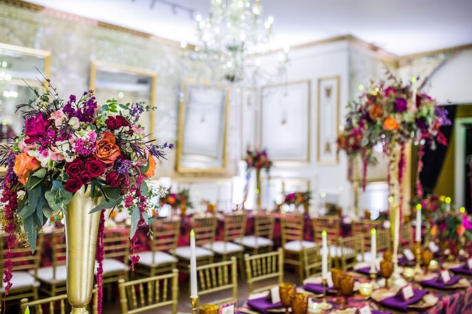 Grand floral arrangements in a glamorous statement wedding