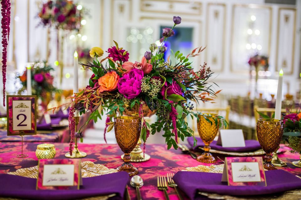 A glamorous floral arrangement with rich pops of color