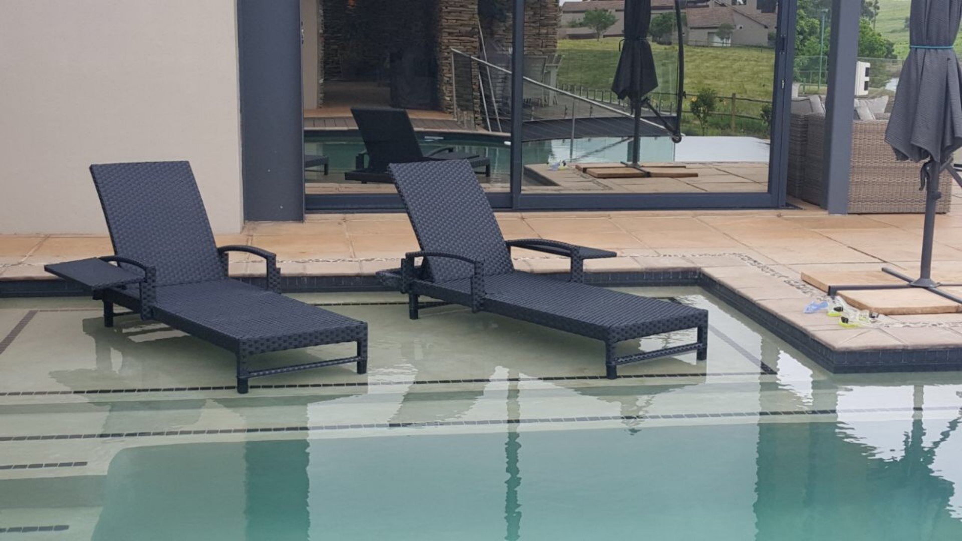 All weather outdoor lounger with tray