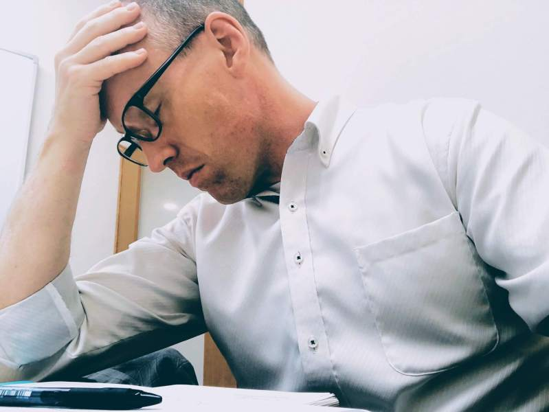 Man at work suffering from Mental health issues. Anxiety. Stress. Wellness. Mindfulness. Meditation.