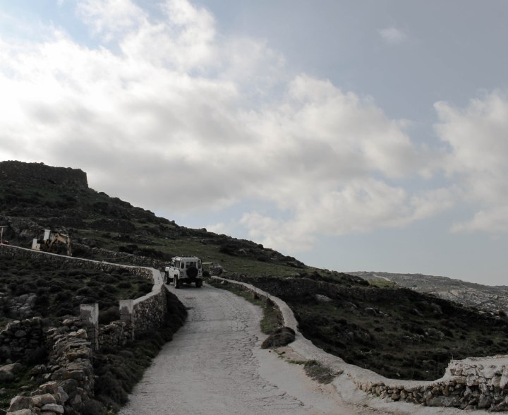 Mykonos road hills clouds