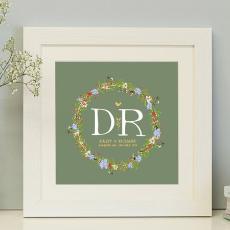 square framed personalised print with a beautiful floral wreath with a green background ideal for weddings, new borns and christenings
