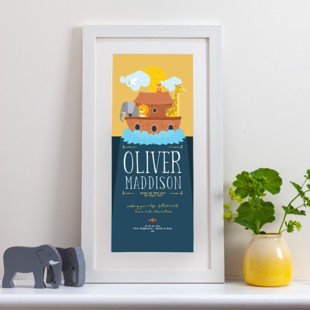 A tall framed personalised print showing a noah's ark with several animals peeping over the side of the boat.