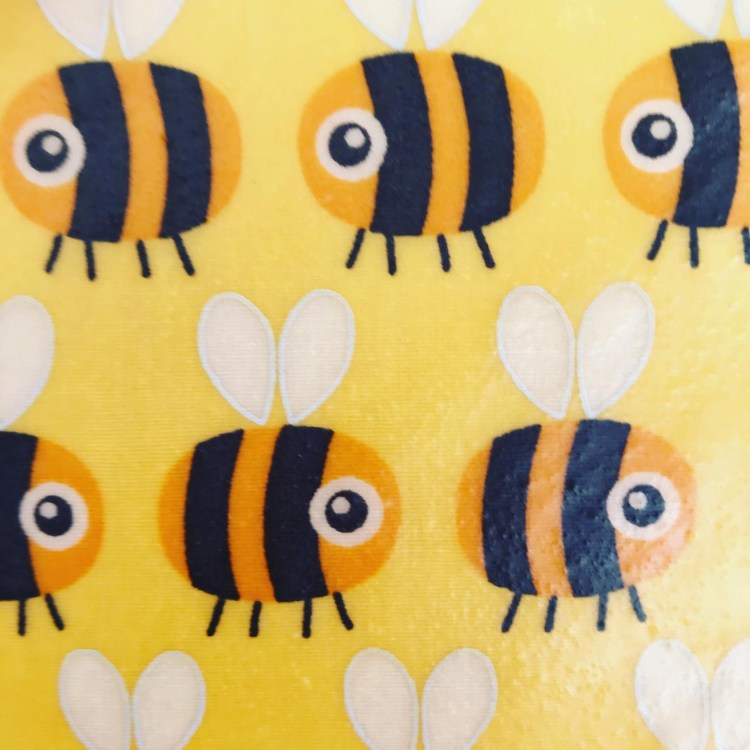 Yellow fabric featuring yellow and black bees