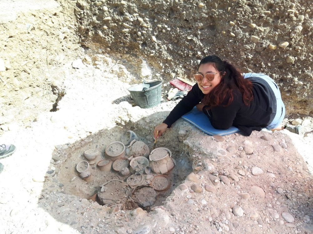 Rebecca Delacruz in front of a pile of ceramics in Spain
