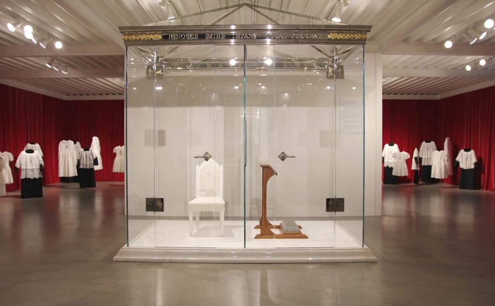 "McKillen's installation called ""Bless Me Child For I Have Sinned"", comprised of an intricately detailed, to-scale confession box made entirely of clear glass."