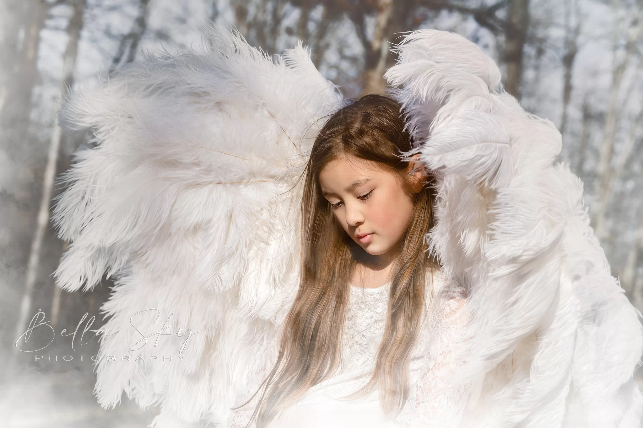 angel with white feather wings