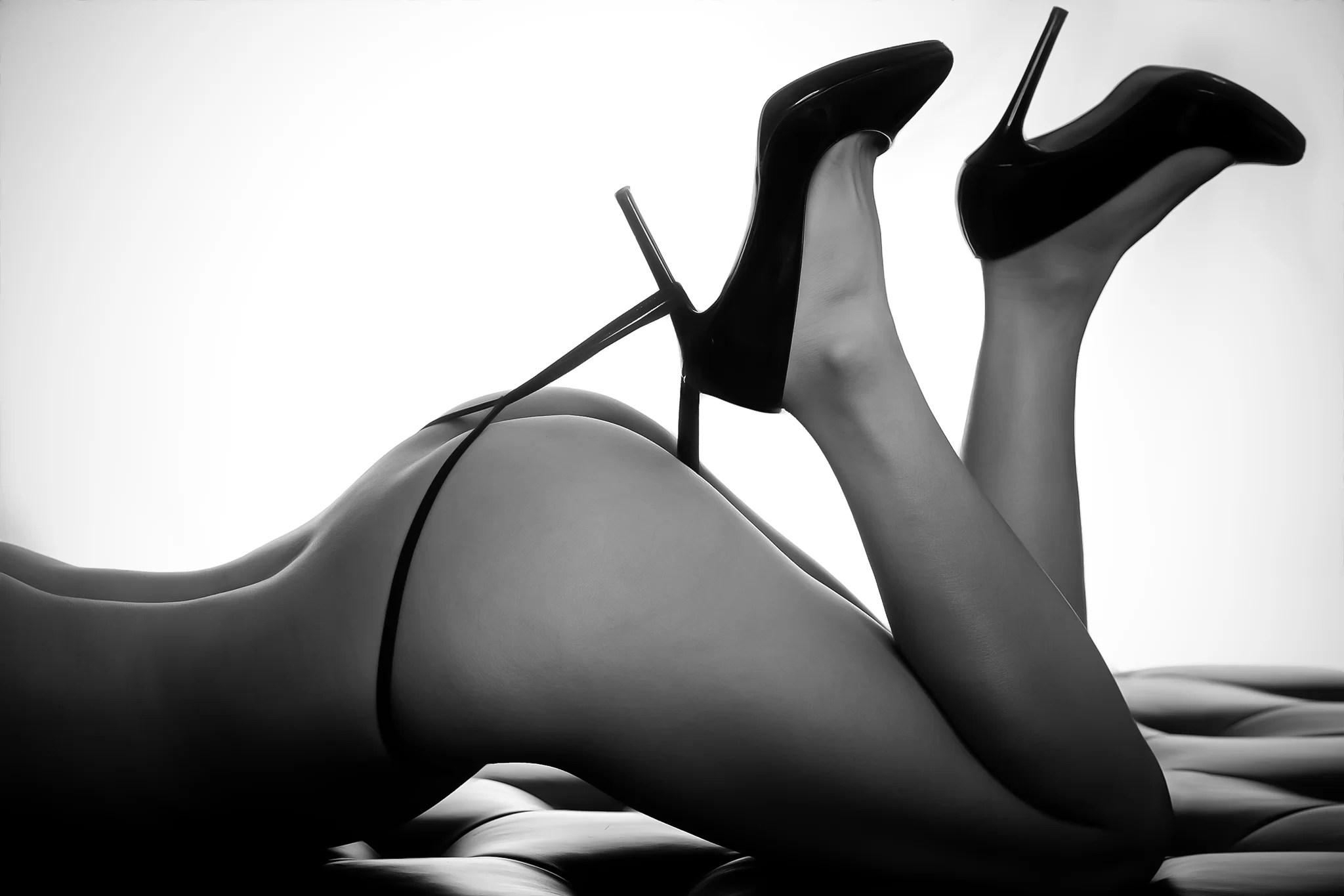woman high heel hooks underwear black and white photo