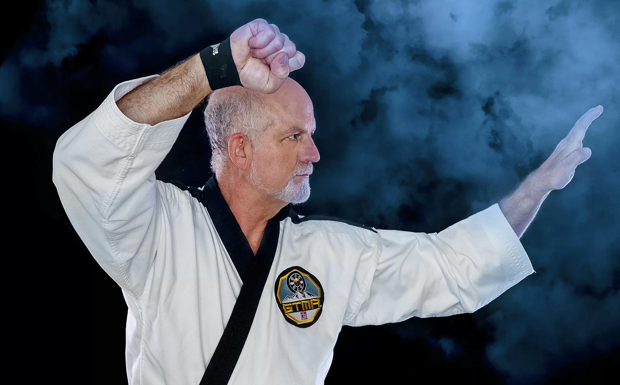 taekwondo black belt instructor action portrait