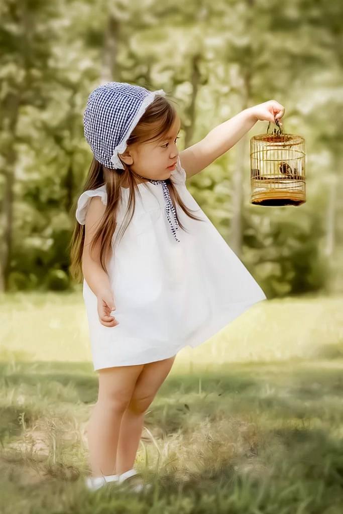 little girl and bird in the forest