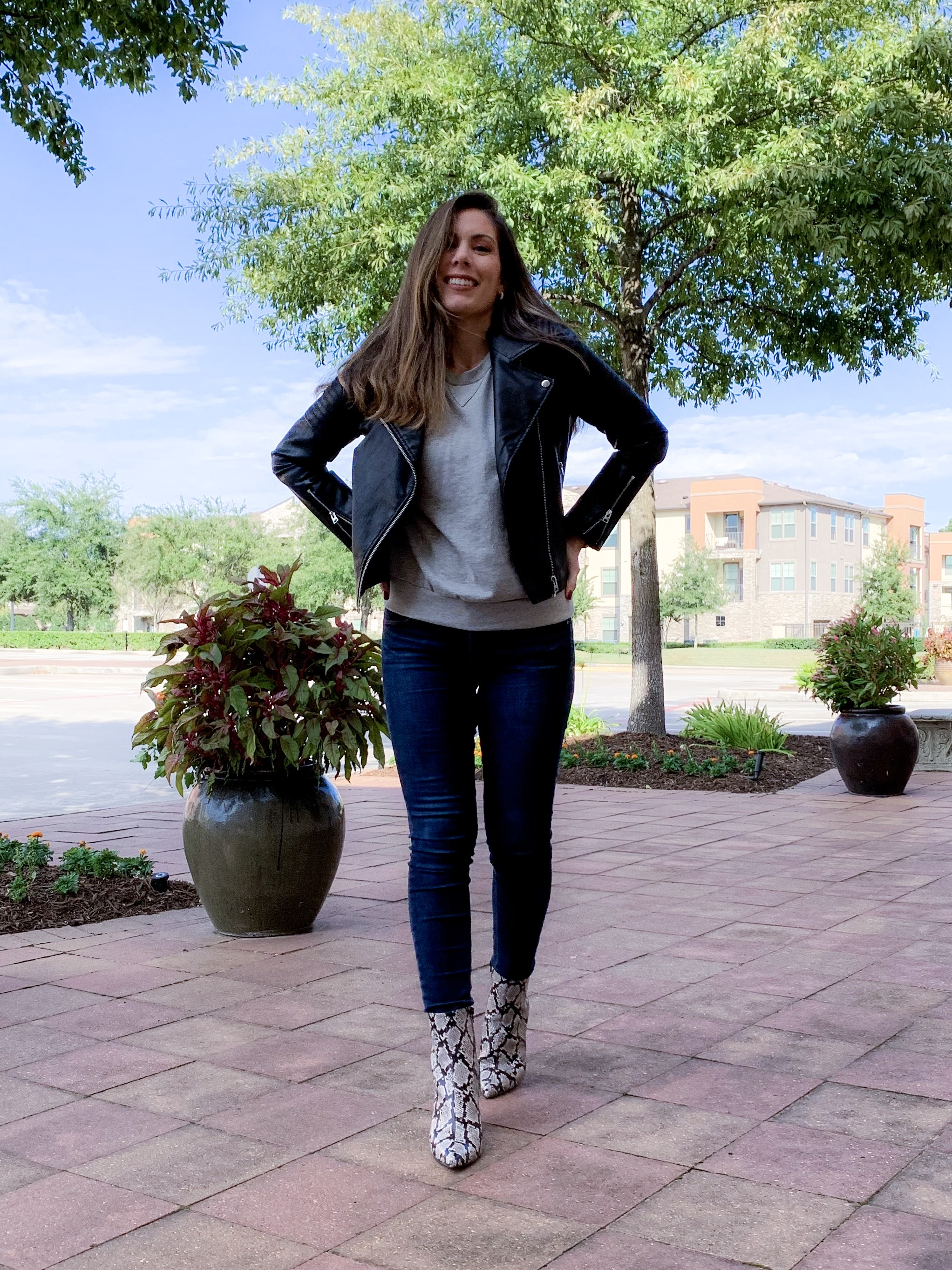 Houston fashion blogger Maria Munoz in snake print trend boots