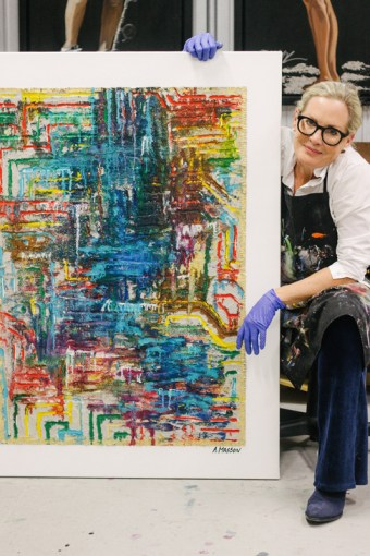 Annemarie Masson with her painting