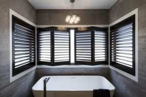 Luxury bathroom ensuite stone tiles freestanding bath brisbane interior monochrome ensuite black bathroom