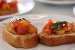 Yellow plum and tomato bruschetta