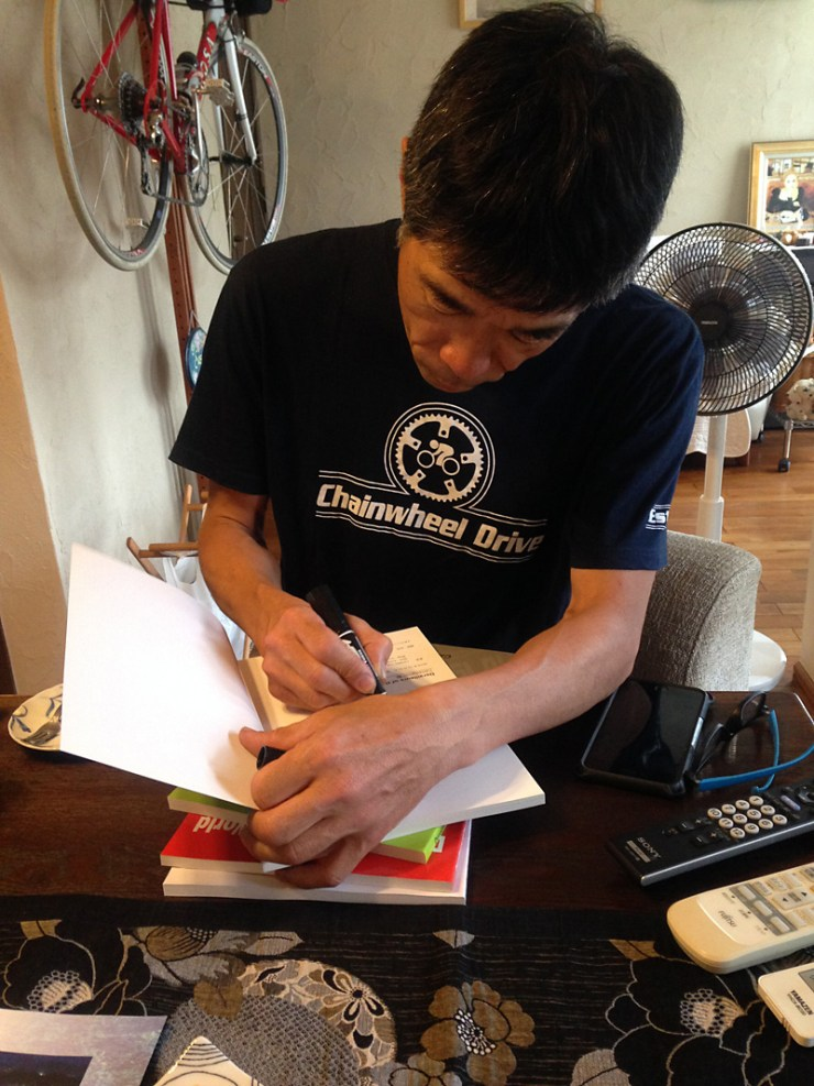 "Sasaki-San signing my copies of ""Derailleurs of the World"""