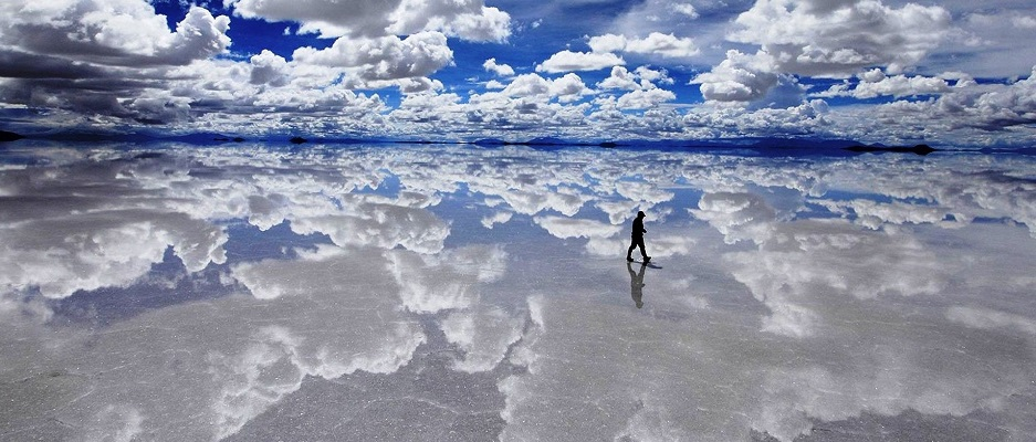 Uyuni Salt Flats, Bolivia– Visible from space Salar de Uyuni is the world's largest salt flat at over 10,500 square kilometres. Covered in a thin layer of water the salt flats create an almost perfect mirror to the sky above, giving you once in a lifetime Instagram opportunities