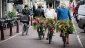 Floral vandals take to the streets of Amsterdam to mark the opening of botanically inspired Kimpton De Witt hotel on June 7, 2017 in Amsterdam, Netherlands. Kimpton De Witt is the first Kimpton hotel to open in Europe.