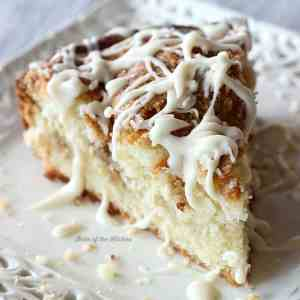 This Greek Yogurt Coffee Cake is out of this world good! It's sprinkled with a crumbly streusel topping then drizzled with a sweet vanilla glaze!