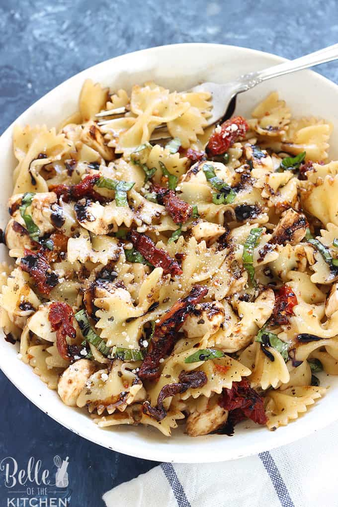 This Caprese Pasta Salad is made with fresh mozzarella, basil, and deliciously juicy sun-dried tomatoes, then covered in a homemade herb dressing. Drizzle with a balsamic reduction and a sprinkle of parmesan cheese for an amazing salad that will become your new favorite!