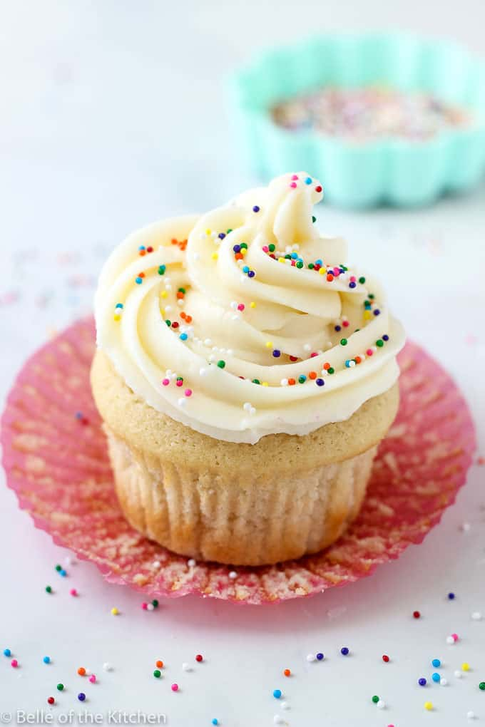 This is The Best Vanilla Buttercream Frosting! It's rich and creamy, and is super easy to whip up. It pipes beautifully, and is the perfect way to finish off all of your cakes and cupcakes!