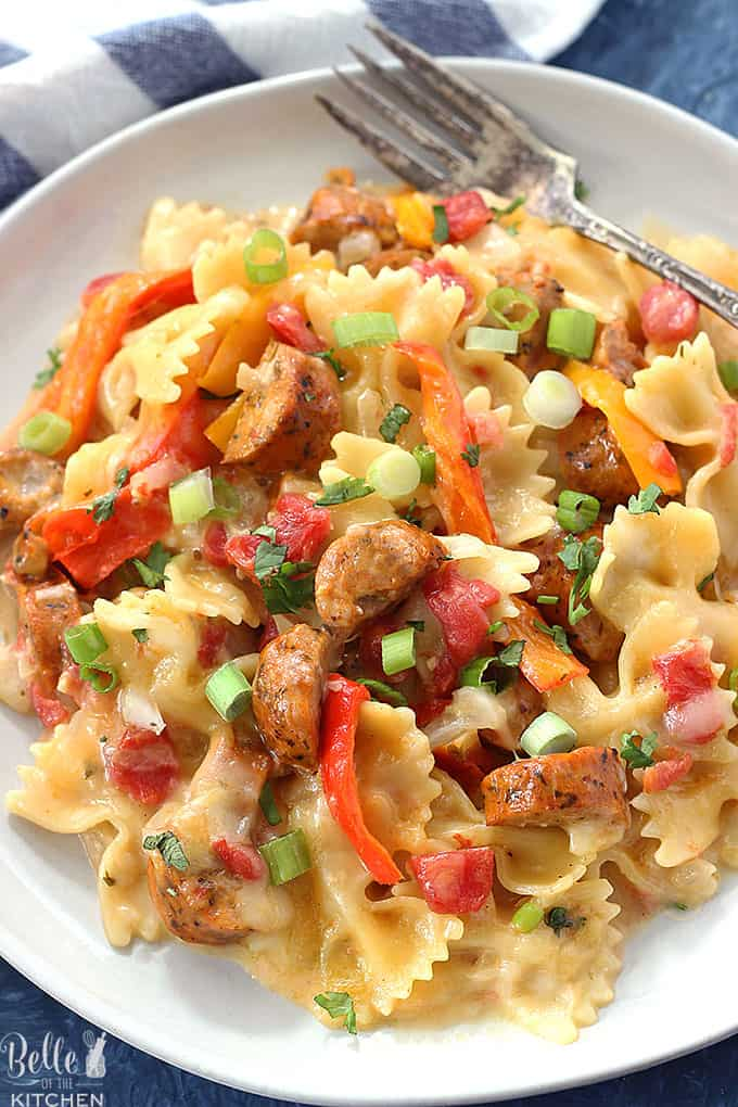 This Cheesy Sausage and Peppers Pasta is made in one pot and is one of our dinner time favorites. It's so easy to make and is perfect for busy weeknights!