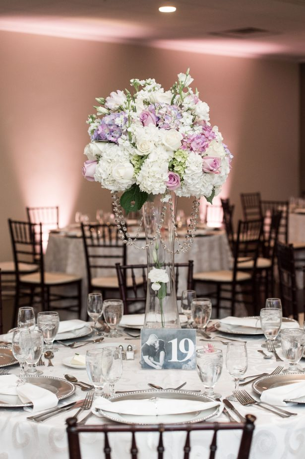 Tall wedding centerpiece with classic floral design and white and lavender flowers - Lynne Reznick Photography