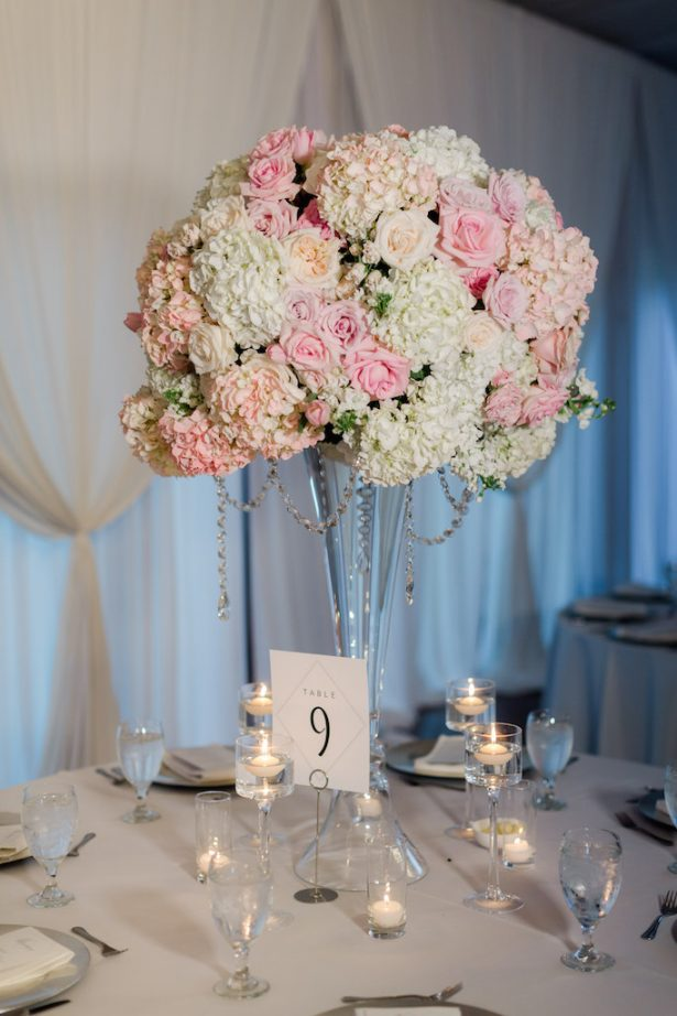 Tall wedding centerpiece with candlelight Krystle Akin Photography
