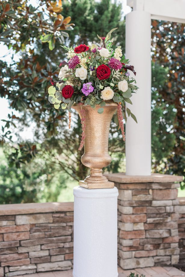 Colorful wedding ceremony flowers with gold vase - Photography: The Hendricks