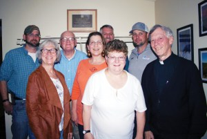 "Father Tom Barrett and St. Paul Catholic Church, Vienna, parish council members Lee Givens, Cathy Hinton, Frank Dueker, Joan Galey, Steve Pobst, Cathy Kruep and Jared Bergmann whose parish recently ""paid it forward."""