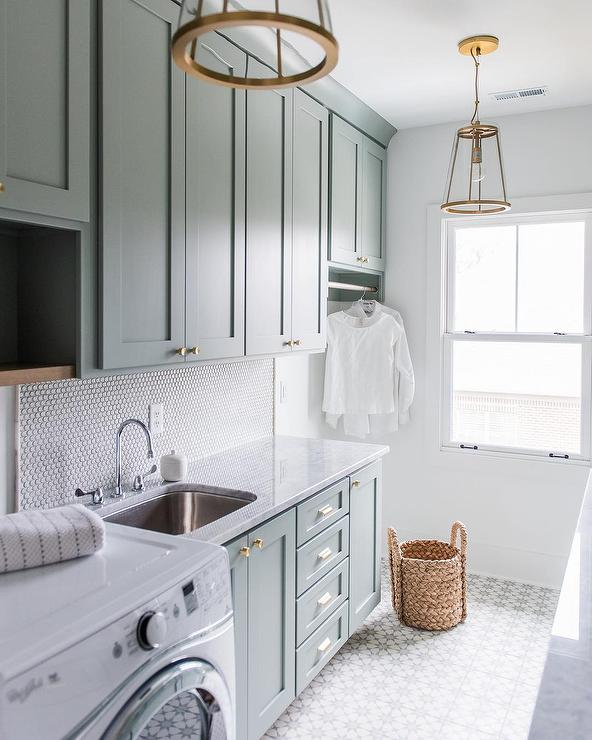 These 9 Stylish Laundry Rooms Will Make You Want To Do ... on Laundry Cabinets Ideas  id=45108