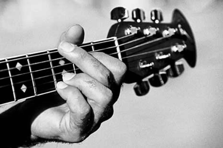 playing-guitar-1500x1000.jpg
