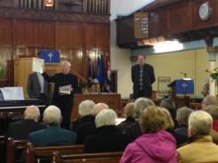 Rev Ian Mackenzie makes the announcement