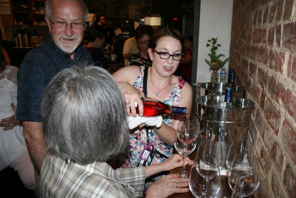 Sara pouring wine