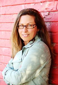 Marcy Gordon, wearing glasses in a portrait