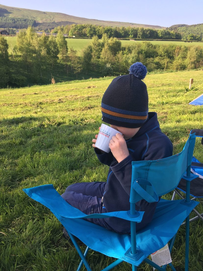 Getting hygge drinking hot chocolate on a chilly morning camping