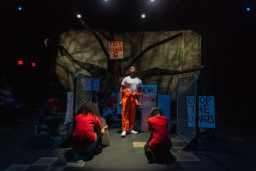 Myles Moore as De'Andre and the cast of the Raleigh Little Theatre production of BLOOD AT THE ROOT.