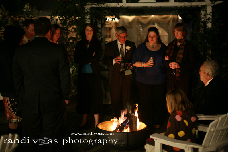 Guests warming by the fire...