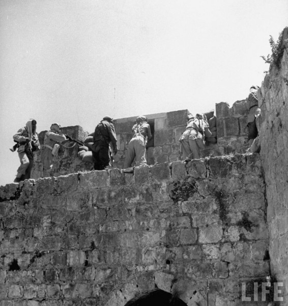 Arab Legionnaires fight from walls of Jerusalem, May 1948. John Phillips