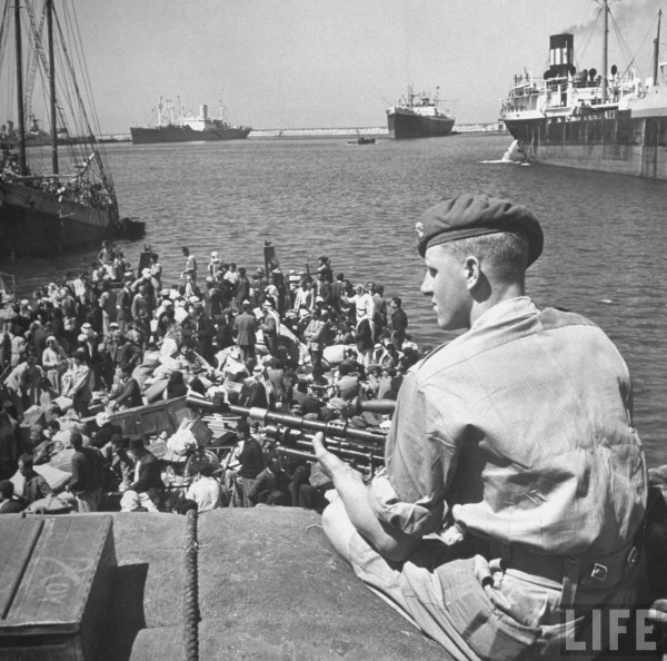 Arab refugees crowding a British ship carrying them to Acre. May 1948. John Phillips