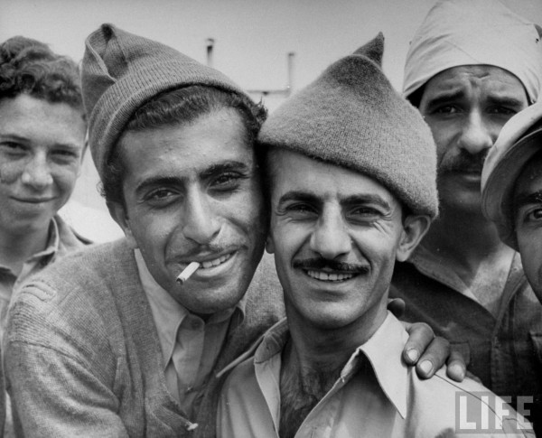 Israeli men celebrate the end of the British Mandate. May 1948. Frank Scherschel