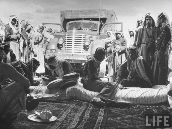 Men of Emir Mohamed Saleh in their camp listening to latest news. April 1948. John Phillips