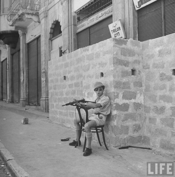 Haganah guard sitting in the Arab sector of Hafia. April 1948. John Phillips