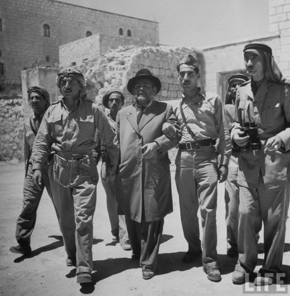 "Mayor of Jewish quarter ""Muhktar"" Weingarten being escorted to Arab Legion headquarters by Arab soldiers. Jerusalem. June 1948. John Phillips"